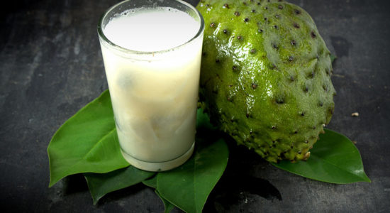 Soursop - Graviola juice in glass with Fresh soursop fruit